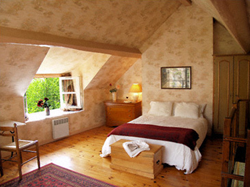 The queen-sized bed in the upper bedroom faces the balcony and town ramparts.